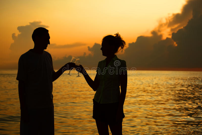 Download Couple Clink Glasses. Silhouettes Against Sea Stock Photo - Image: 11630782