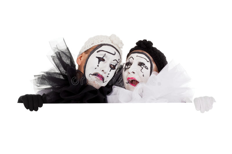 Two clowns are crying and sad royalty free stock photography
