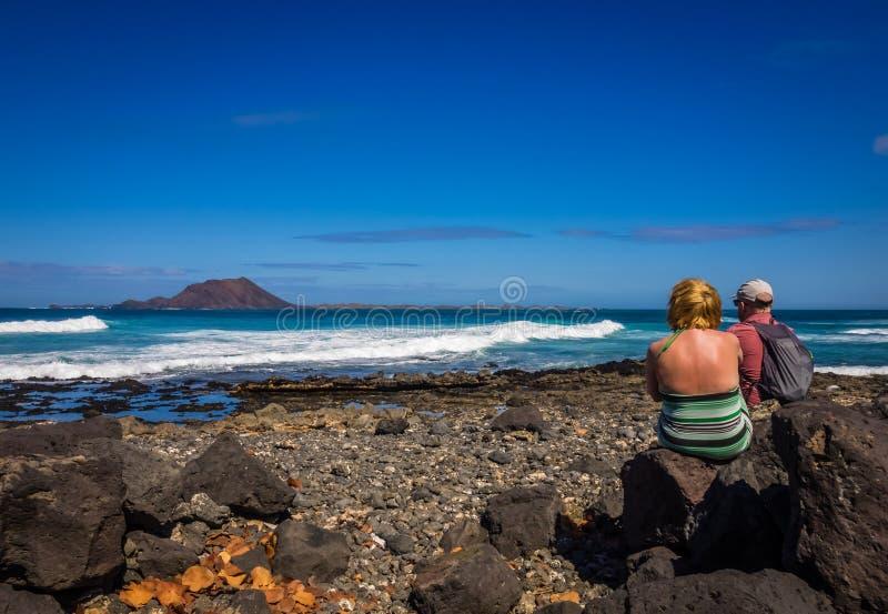 Couple on the coast stock image