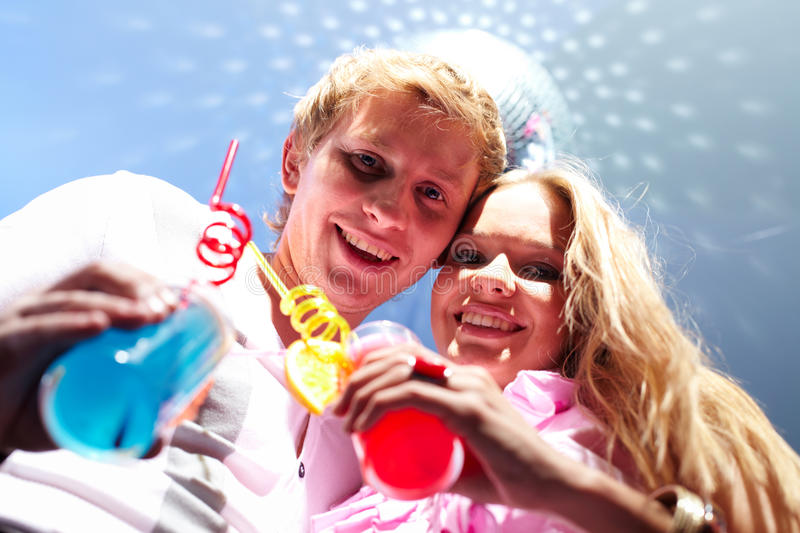Couple with cocktails stock images