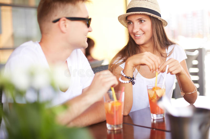 Couple with cocktails stock photography