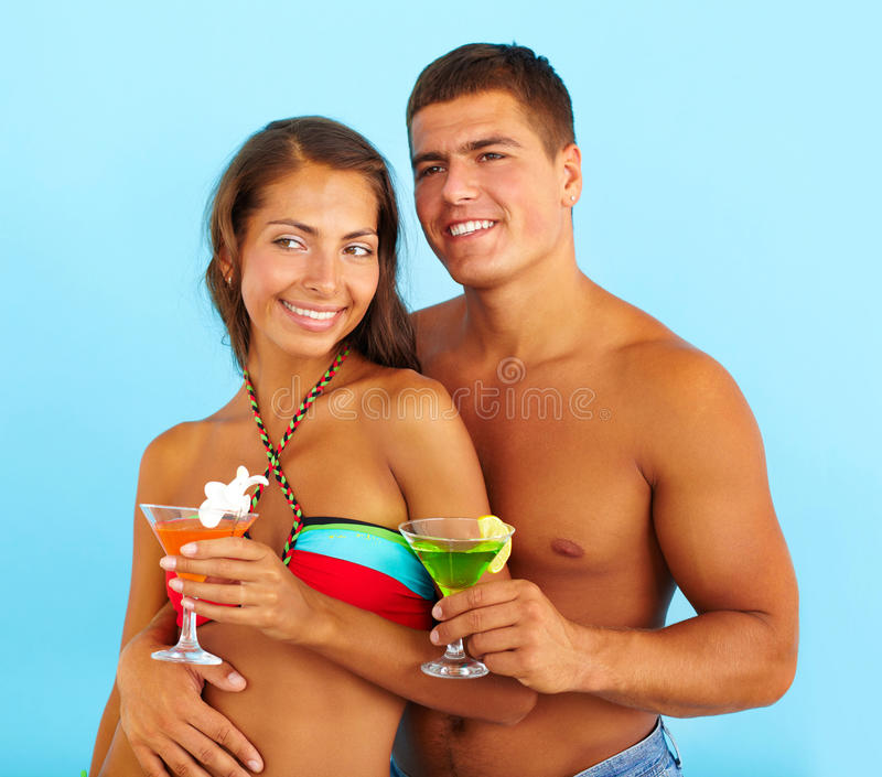 Couple with cocktails royalty free stock photo