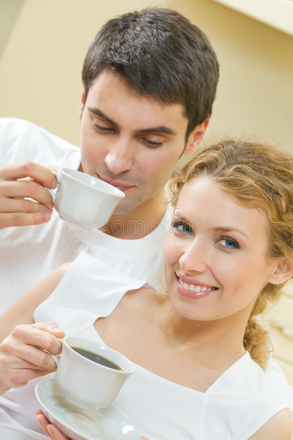 Couple with coffee at home royalty free stock photography