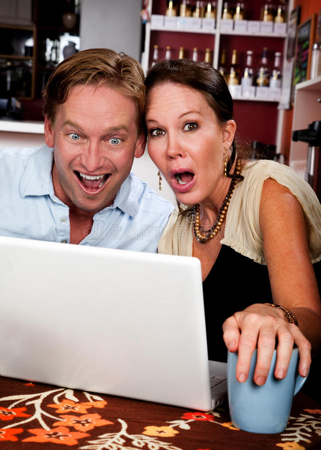 Couple in Coffee House with Laptop Computer royalty free stock photos