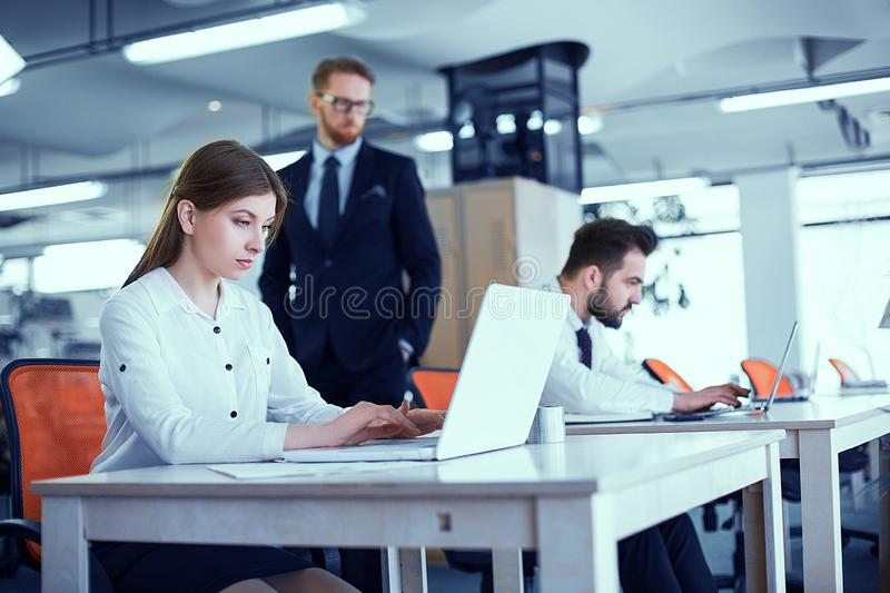 A couple of colleagues at the desk stock photo