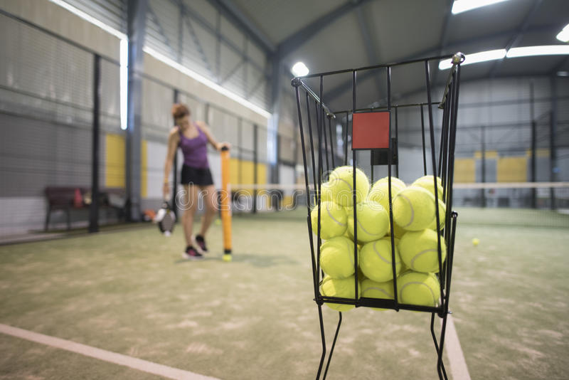 Couple collects balls with tube after paddle class. To continue training royalty free stock photos