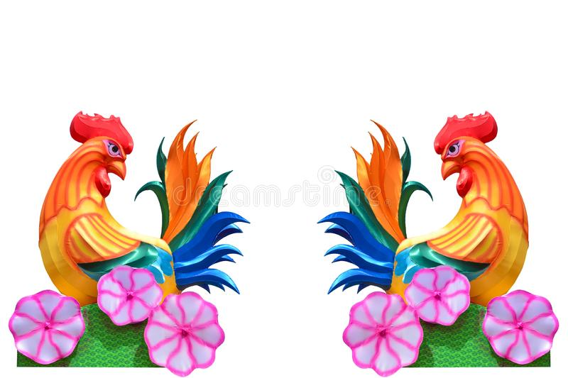 Couple of colorful fabric chickens lunar lanterns signs of the zodiac isolated on white background stock image