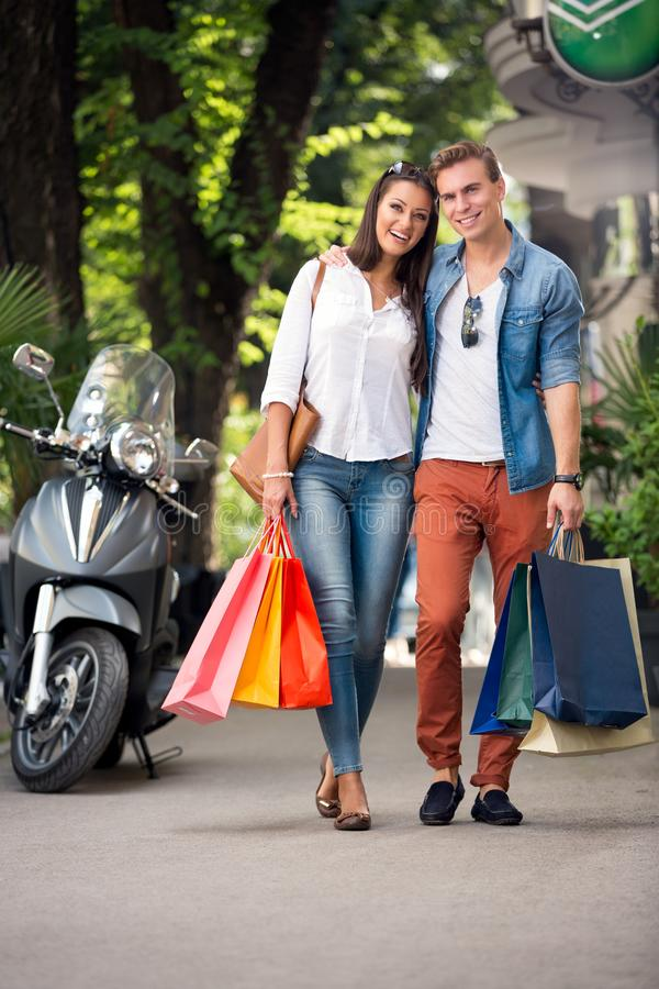 Couple coming back from the shopping stock image