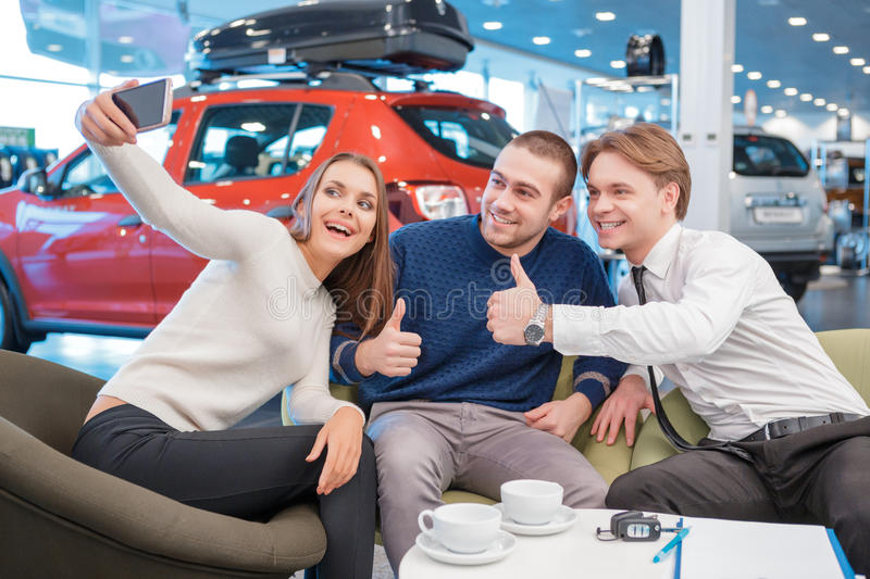 Couple communicating with the salesman in showroom royalty free stock image
