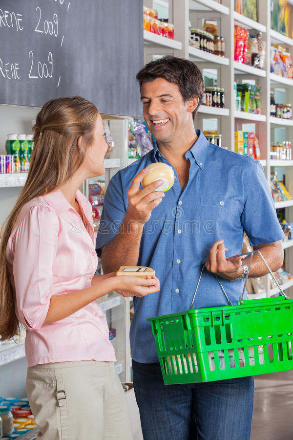 Download Couple Comparing Cheese At Grocery Store Stock Photo - Image of discussing, female: 37112478