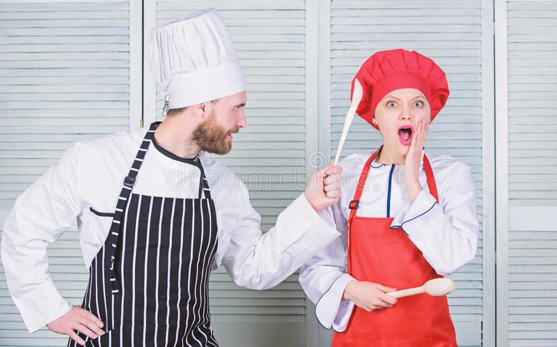 Couple compete in culinary arts. Kitchen rules. Culinary battle concept. Woman and bearded man culinary show competitors. Couple compete in culinary arts stock image