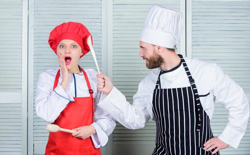 Couple compete in culinary arts. Kitchen rules. Culinary battle concept. Woman and bearded man culinary show competitors. Couple compete in culinary arts royalty free stock photos