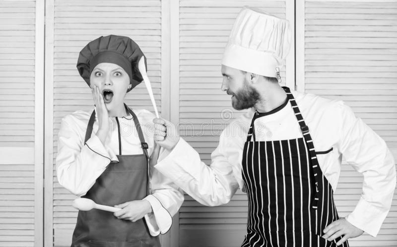 Couple compete in culinary arts. Kitchen rules. Culinary battle concept. Woman and bearded man culinary show competitors. Couple compete in culinary arts royalty free stock images