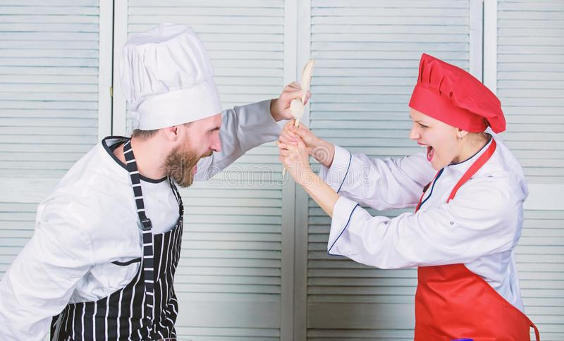 Couple compete in culinary arts. Kitchen rules. Who cook better. Culinary battle concept. Woman and bearded man culinary. Couple compete in culinary arts royalty free stock image