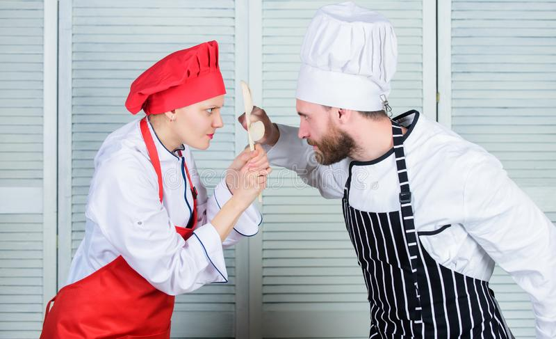 Couple compete in culinary arts. Who cook better. Culinary battle concept. Woman and bearded man culinary show. Couple compete in culinary arts. Who cook better stock images