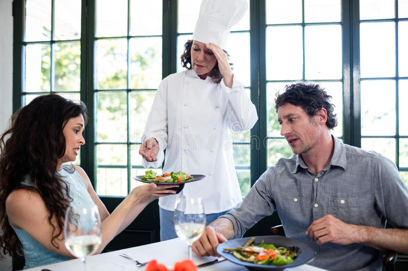 Couple complaining about the food to chef stock images