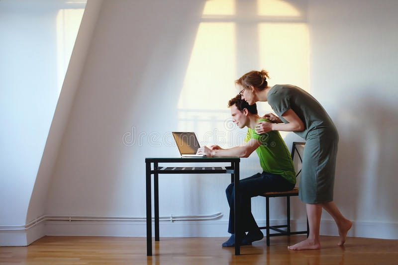 Couple with computer at home stock images