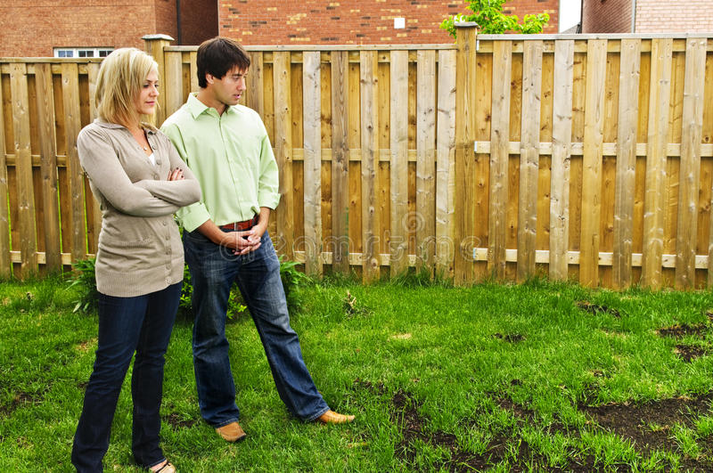 Couple concerned about lawn royalty free stock photography