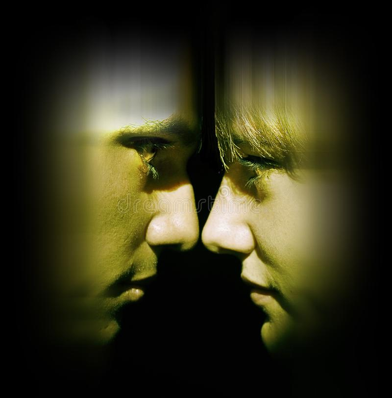 Couple confrontation. Man and woman confronting face to face in a blurry atmosphere stock photography