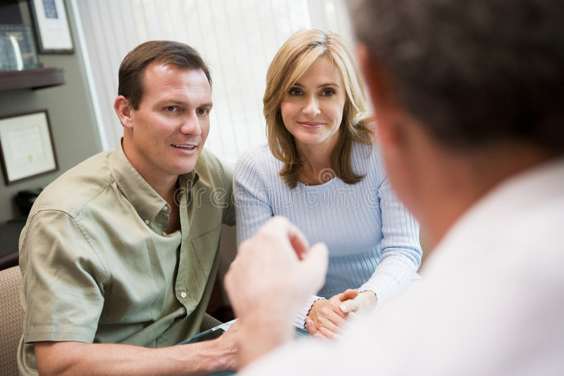 Couple in consultation at IVF clinic stock image