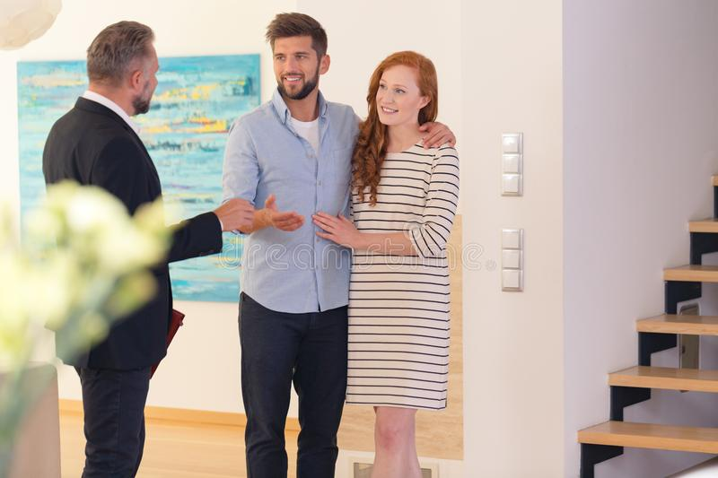 Couple consulting with estate agent stock image