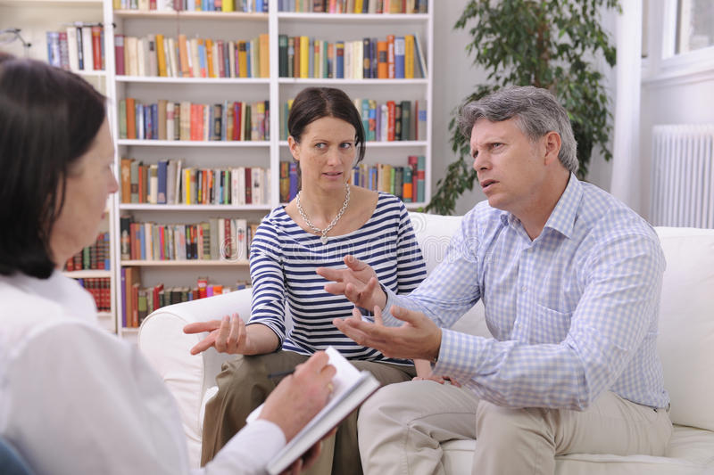 COUPLE CONSULTS TALKING TO PSYCHOLOGIST stock photo