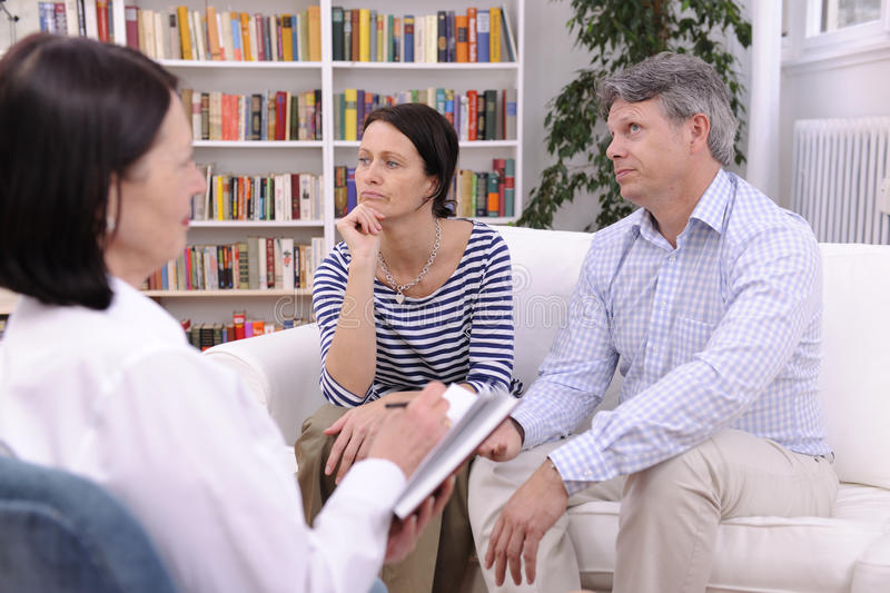 Couple consults talking to psychologist royalty free stock images