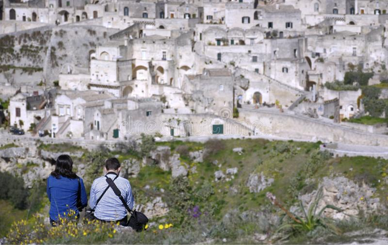 Couple in contemplation of the city of matera from the heights placed in front royalty free stock images