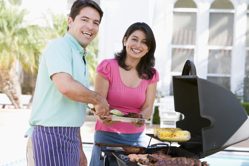 Download Couple Cooking On A Barbeque Stock Photo - Image: 7230378