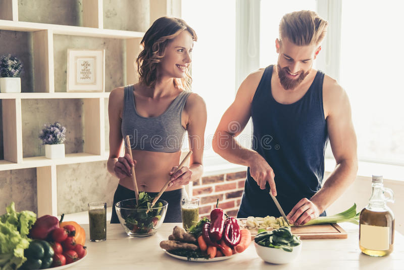 Couple cooking healthy food stock images