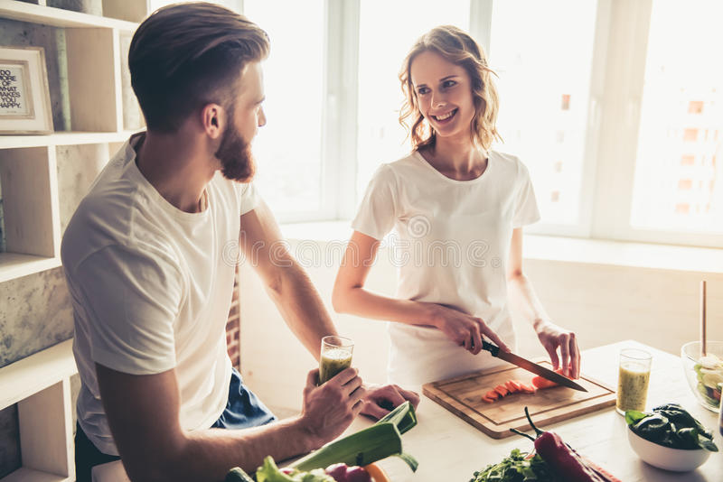 Couple cooking healthy food royalty free stock image