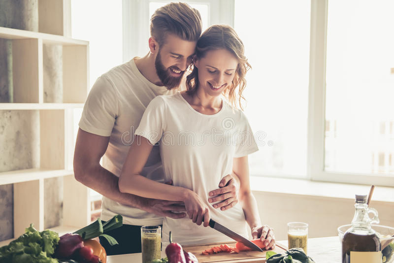 Couple cooking healthy food stock image
