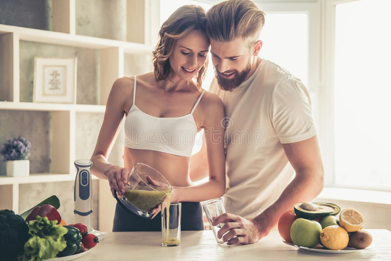 Couple cooking healthy food royalty free stock images