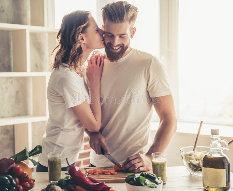 Couple cooking healthy food stock photos