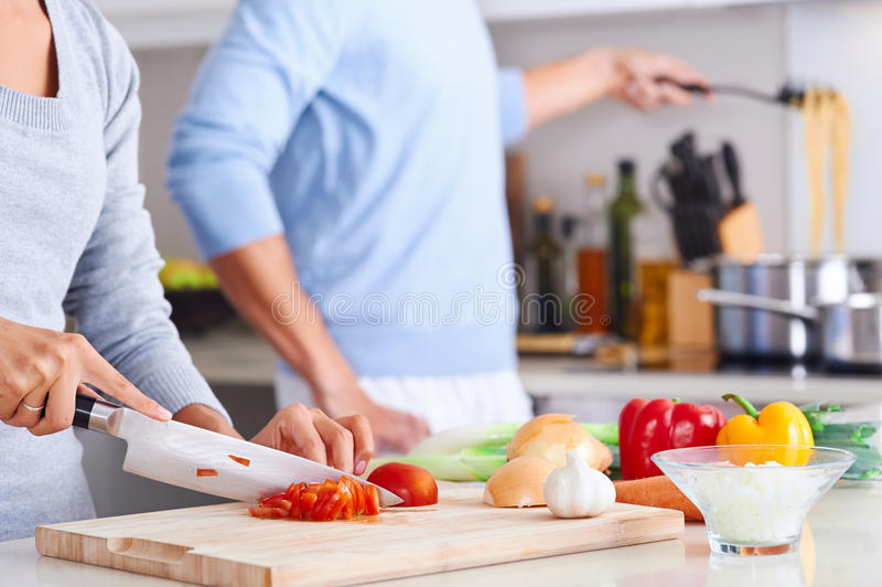 Healthy food cook. Couple cooking healthy food in kitchen lifestyle meal preparation royalty free stock image