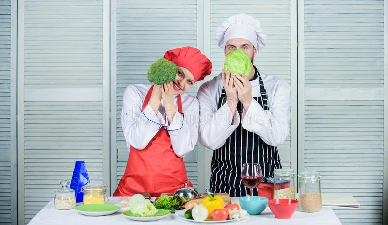 Couple cooking healthy vegetarian meal. Vegetarian family. Vegetarian nutrition and vegetable diet. Diet on their mind stock photography