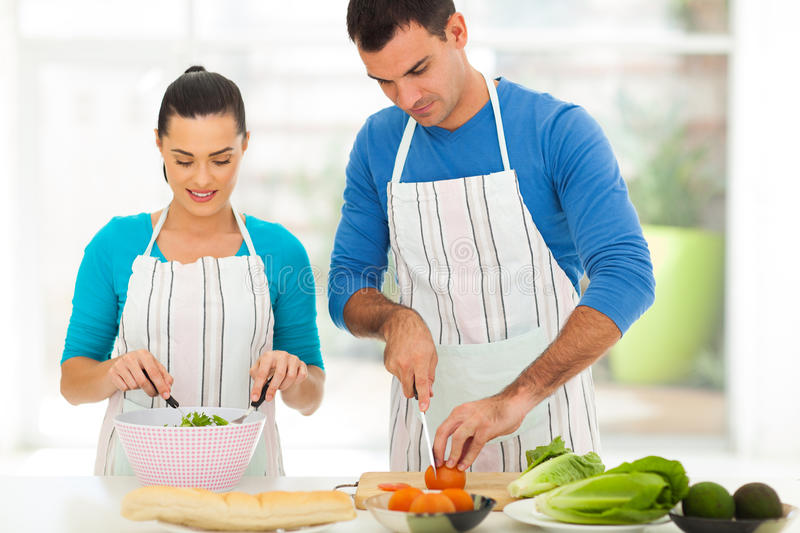 Couple cooking home stock images