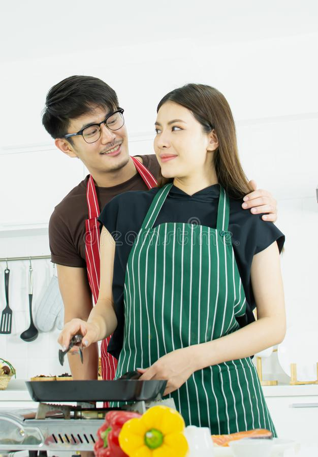 A couple is cooking in the kitchen royalty free stock images