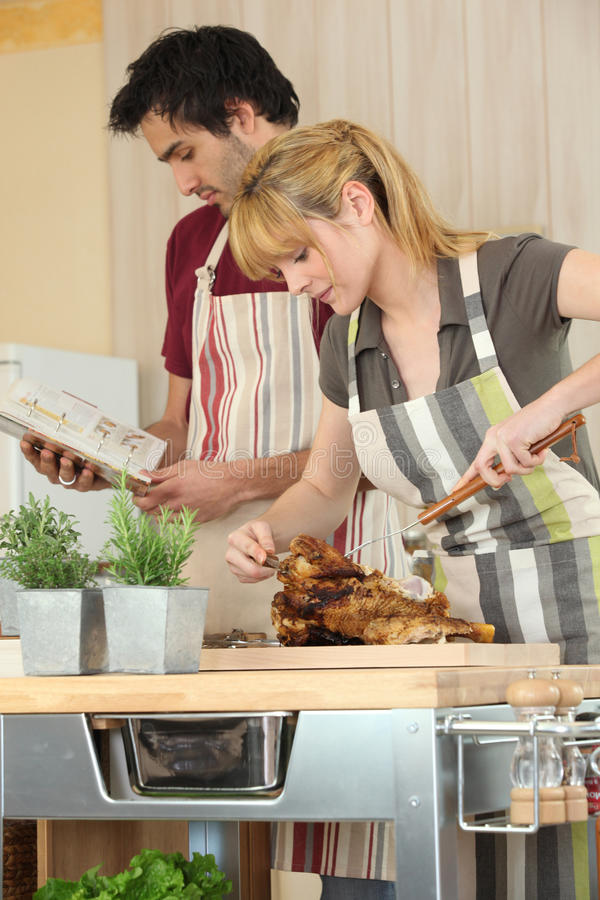 Couple Cooking Roast Chicken Stock Photography
