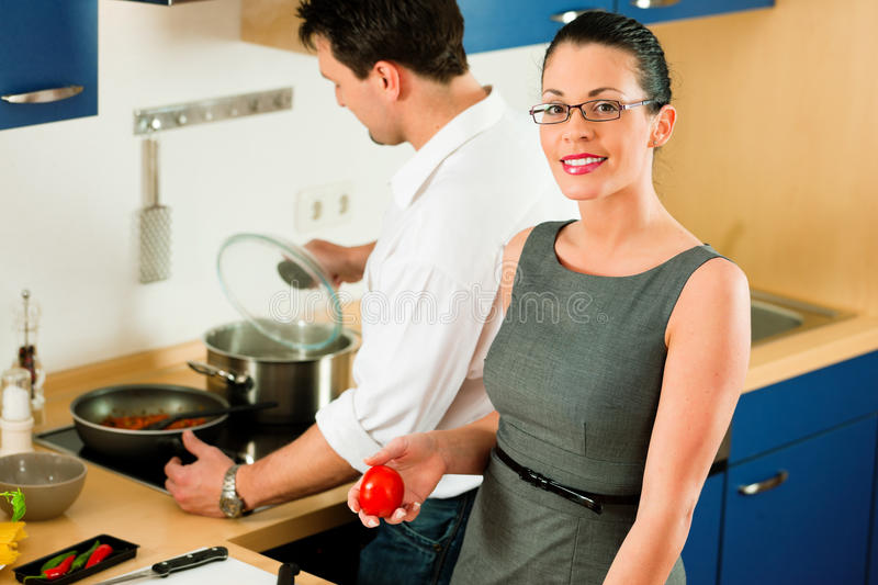 Download Couple Cooking Together In Kitchen Royalty Free Stock Photo - Image: 24766845