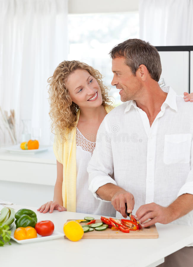 Download Couple Cooking Together In Their Kitchen Stock Photo - Image: 18107498