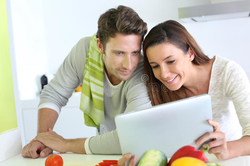 Download Couple Cooking And Using Tablet Stock Image - Image: 30598125