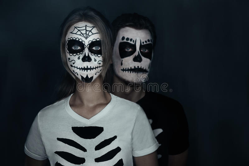 couple in costumes of skeletons stock photo image 46088318. Black Bedroom Furniture Sets. Home Design Ideas