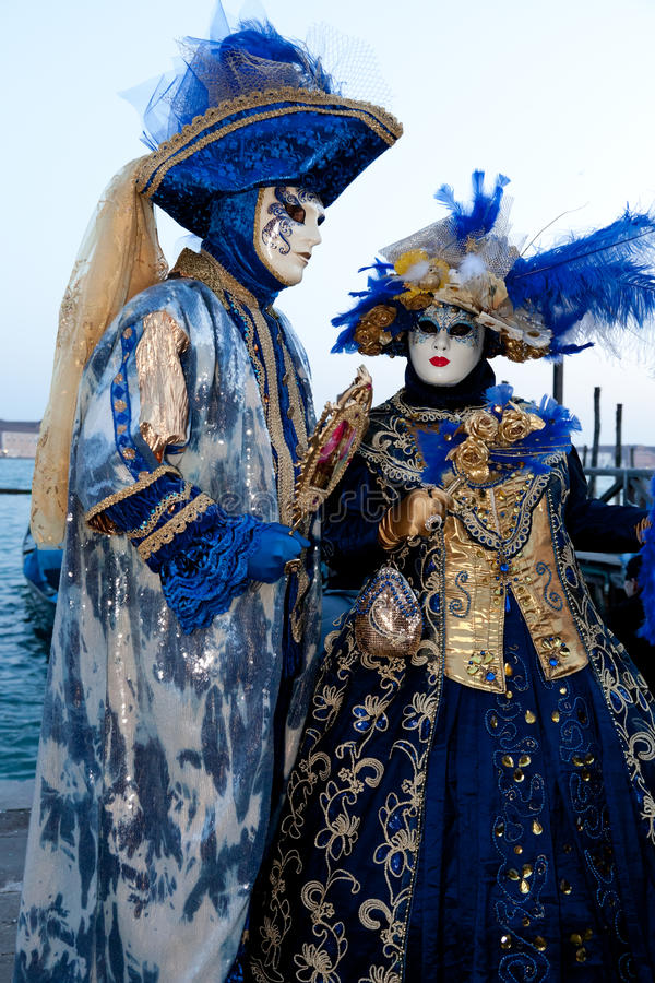 Couple in costumes on Venetian carnival