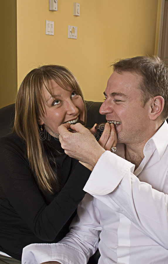 Download Couple On Couch Eating Chocolate Stock Image - Image: 1885769