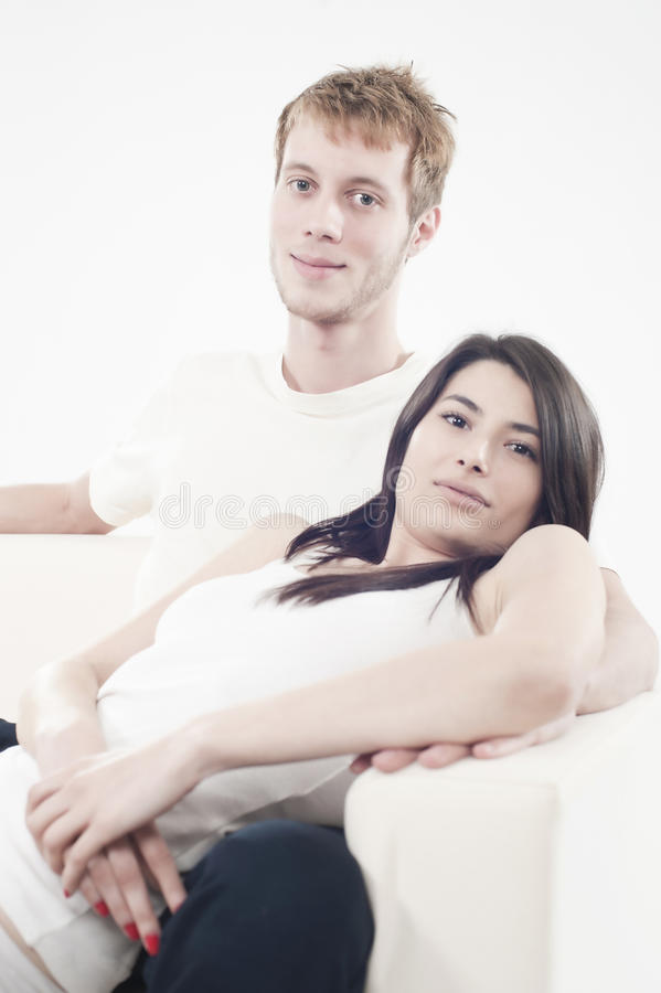 Couple On Couch In Living Room Stock Images