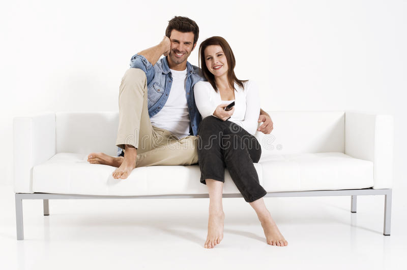 Download Couple On The Couch Watching TV Stock Photo - Image: 17993642