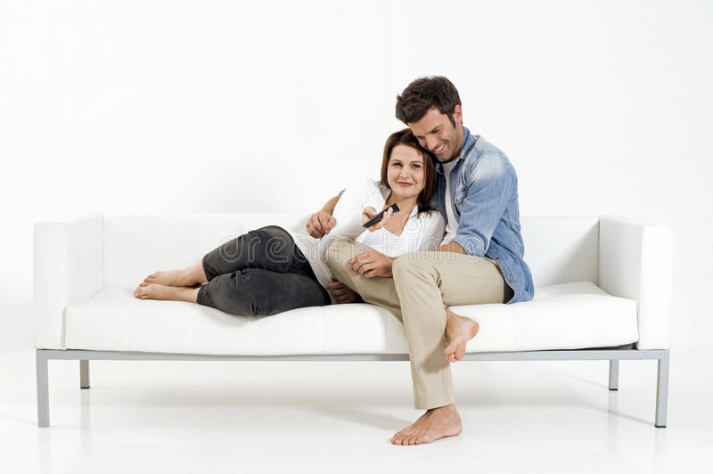 Download Couple On The Couch Watching TV Stock Photo - Image: 17993678