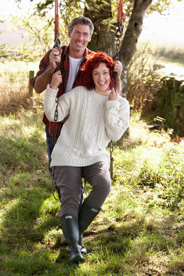 Download Couple With Country Garden Swing Stock Photo - Image: 21408530