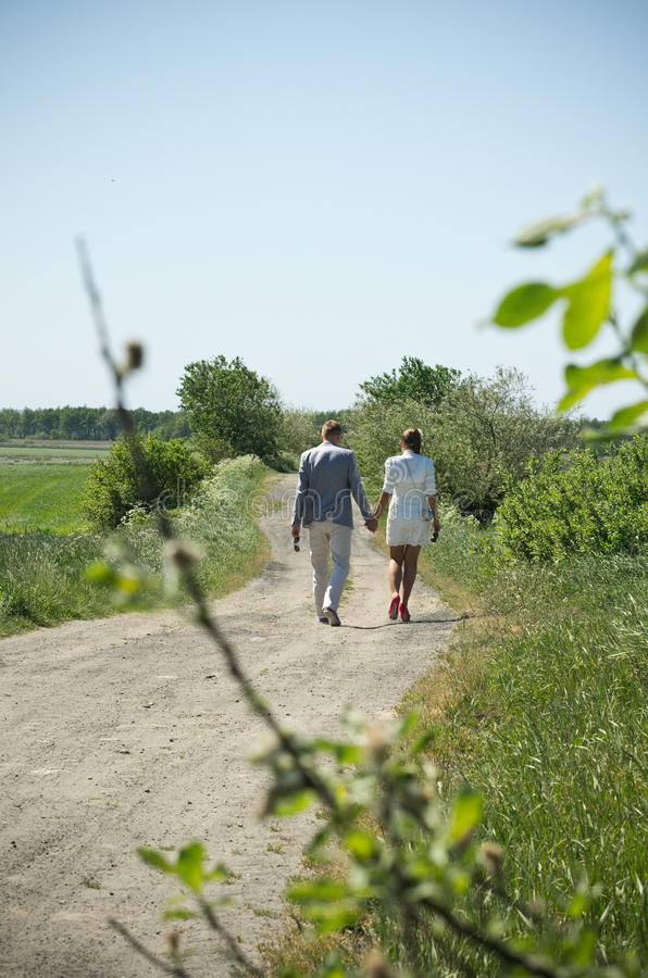 Couple on country path royalty free stock image